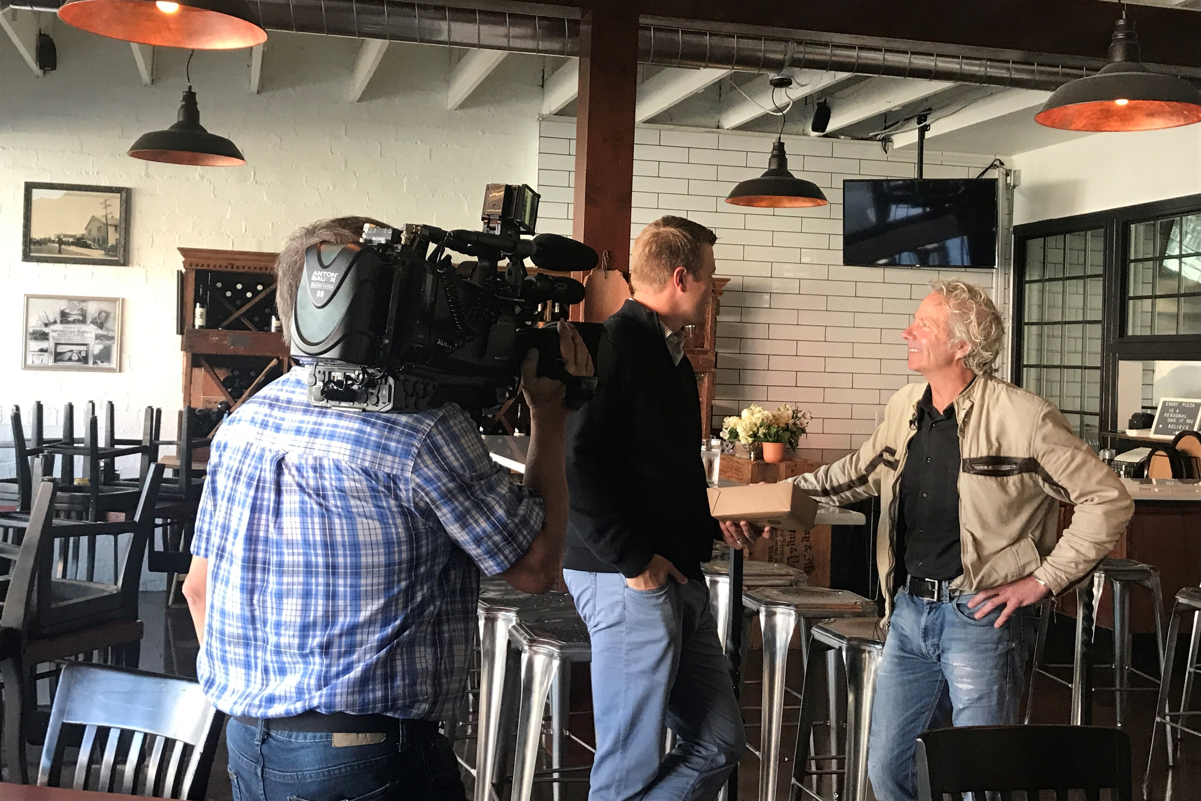 Danny conducting an interview with KING 5 News in the Burien Pizzeria