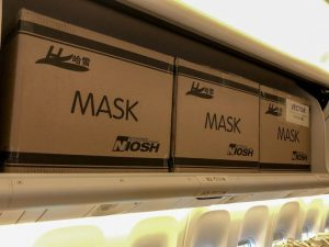 Packages loaded into the overhead bins in a passager cabin of an airplane